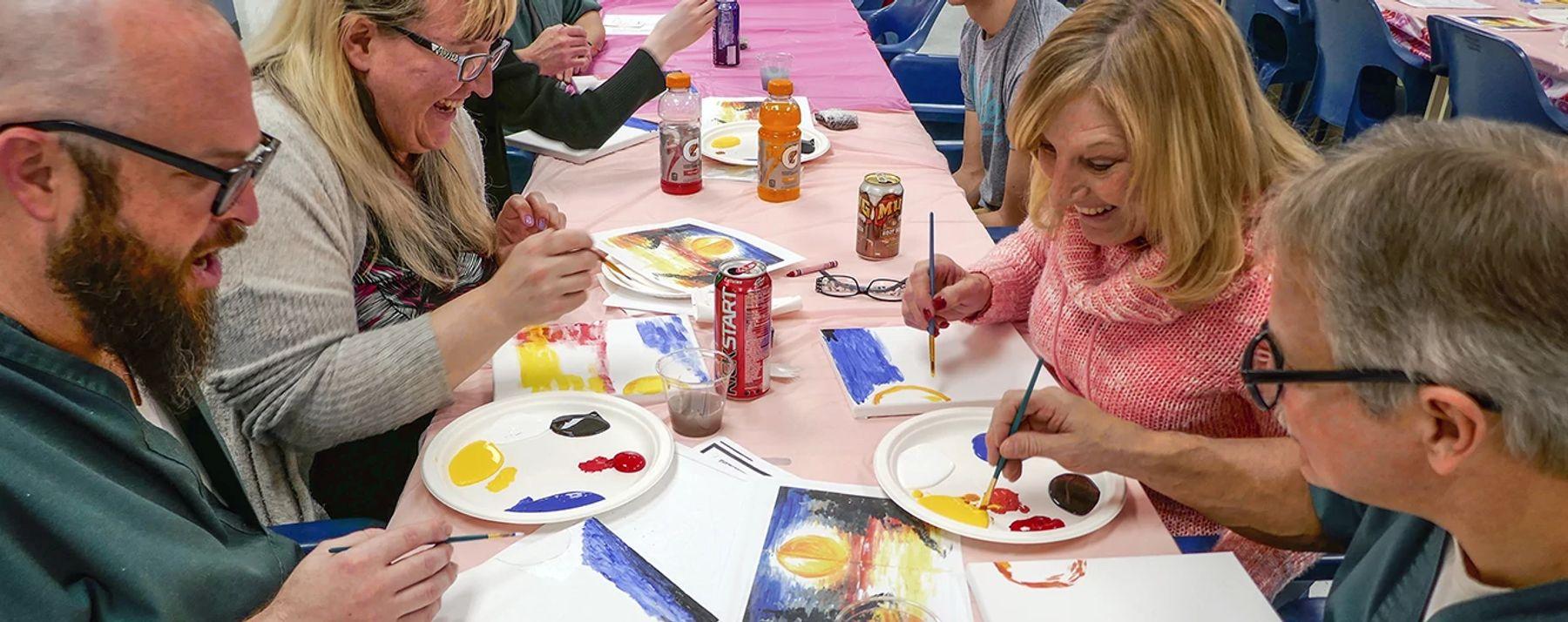 DU PAI families participate in a art project.