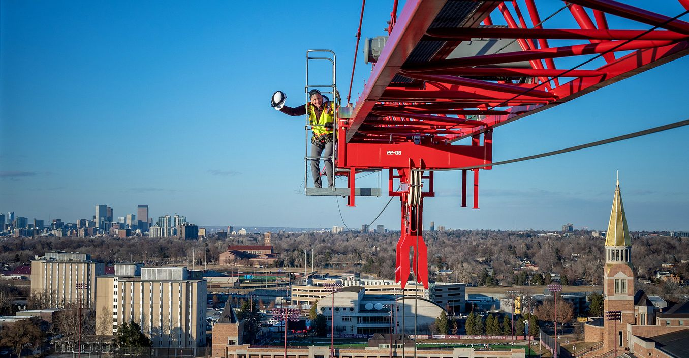 Chancellor Jeremy Haefner on a construction crane