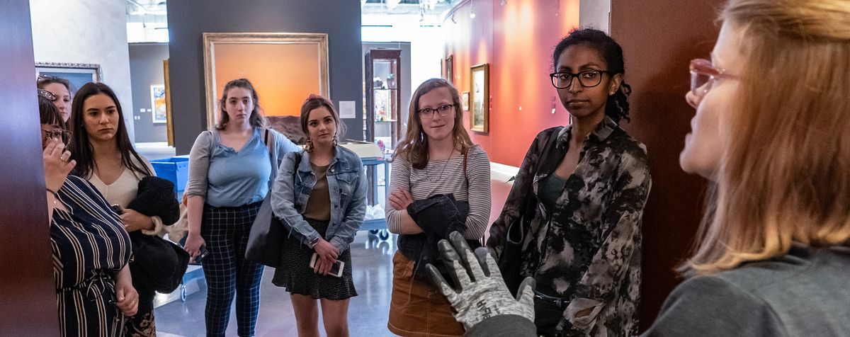 students in discussion in art museum