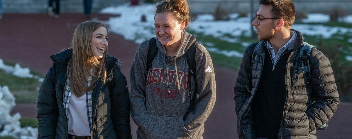 students walking across DU's campus
