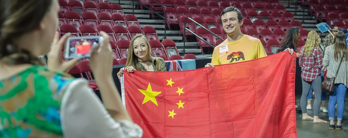 students holding chinese flag