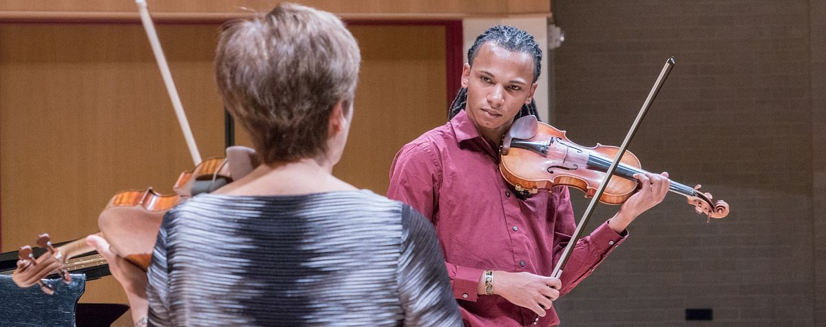 violin instructor with student