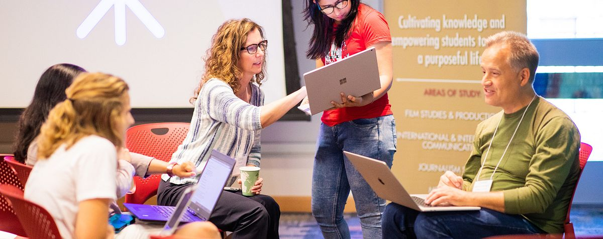 Students work with faculty and local professionals during Colorado Migrahack