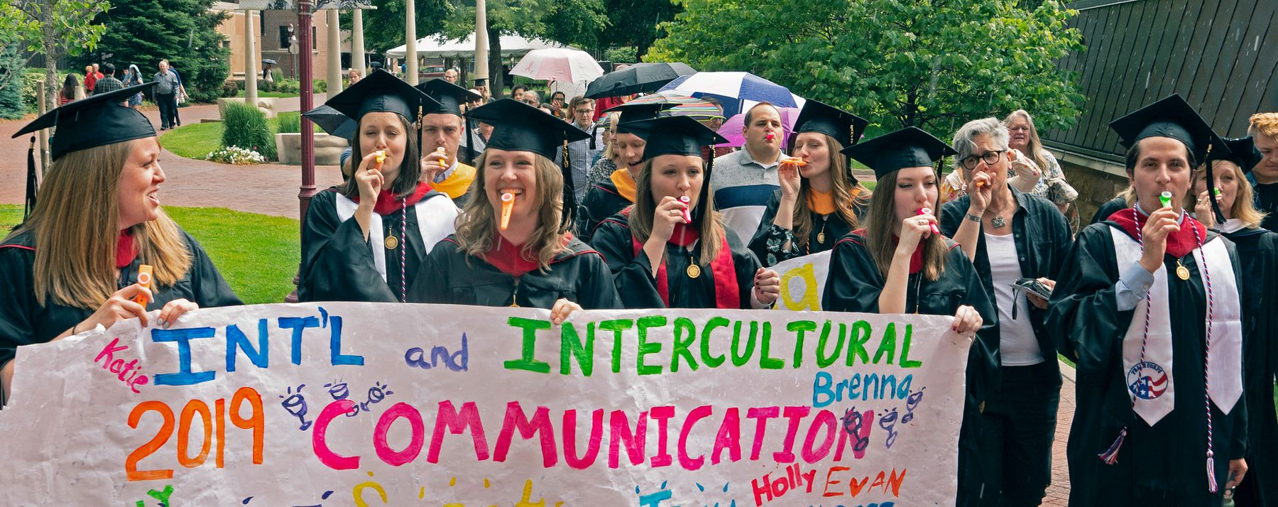 Intercultural and International Communication graduates celebrate.