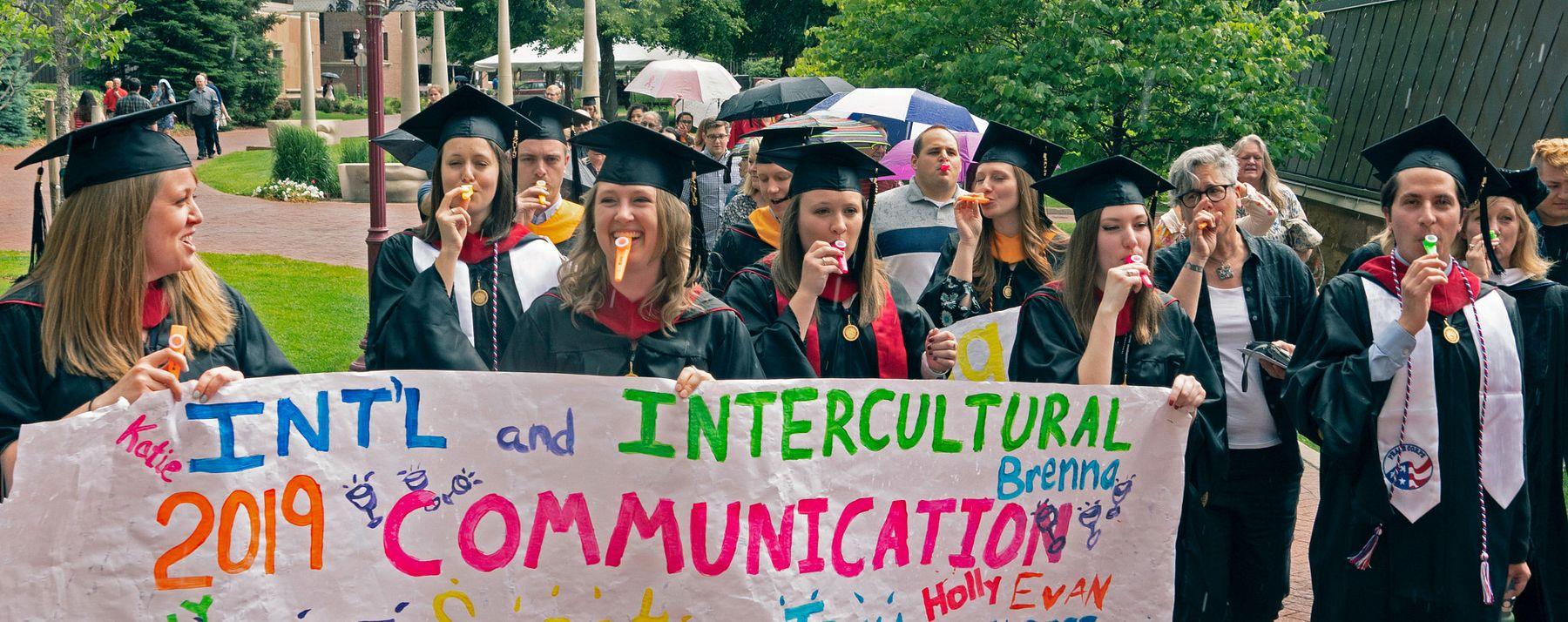 Intercultural and International Communications graduates celebrate.