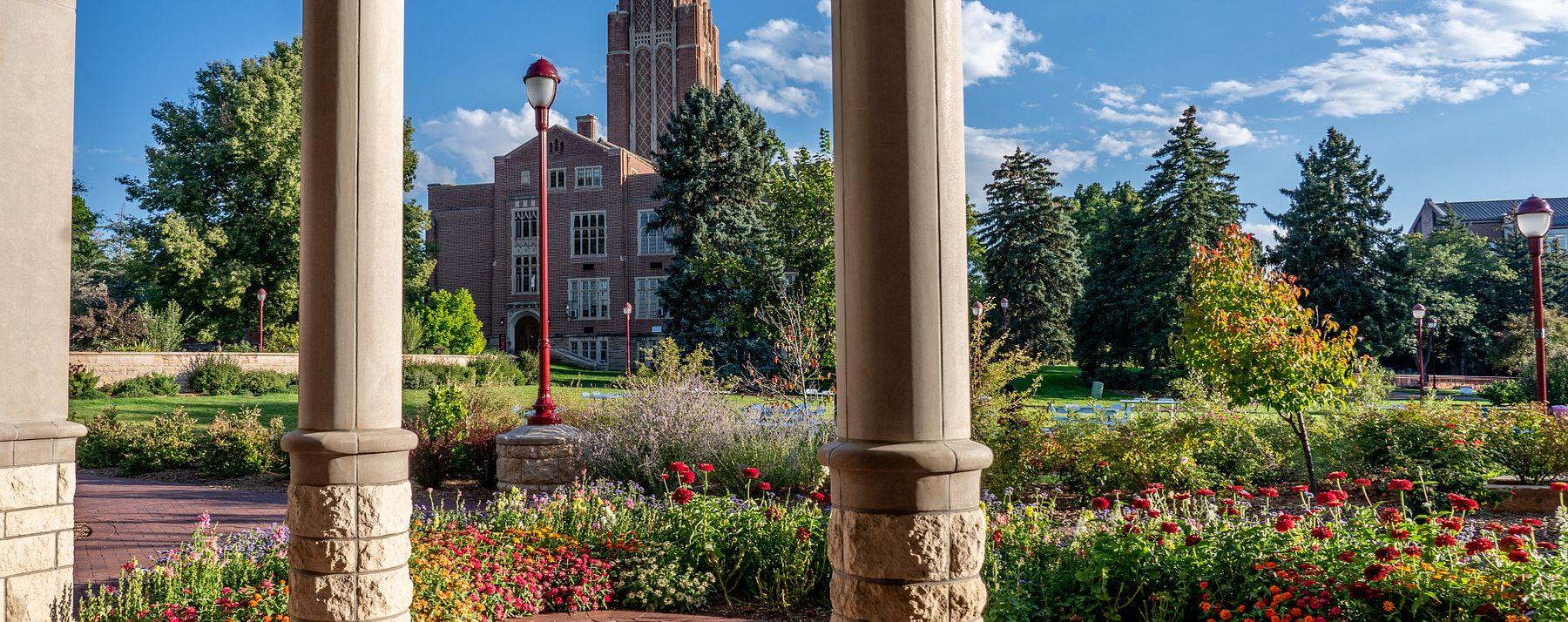 campus shot behind stone columns