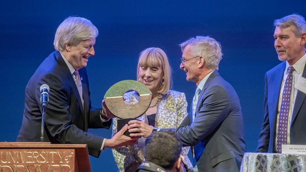 Chancellor Haefner presenting award