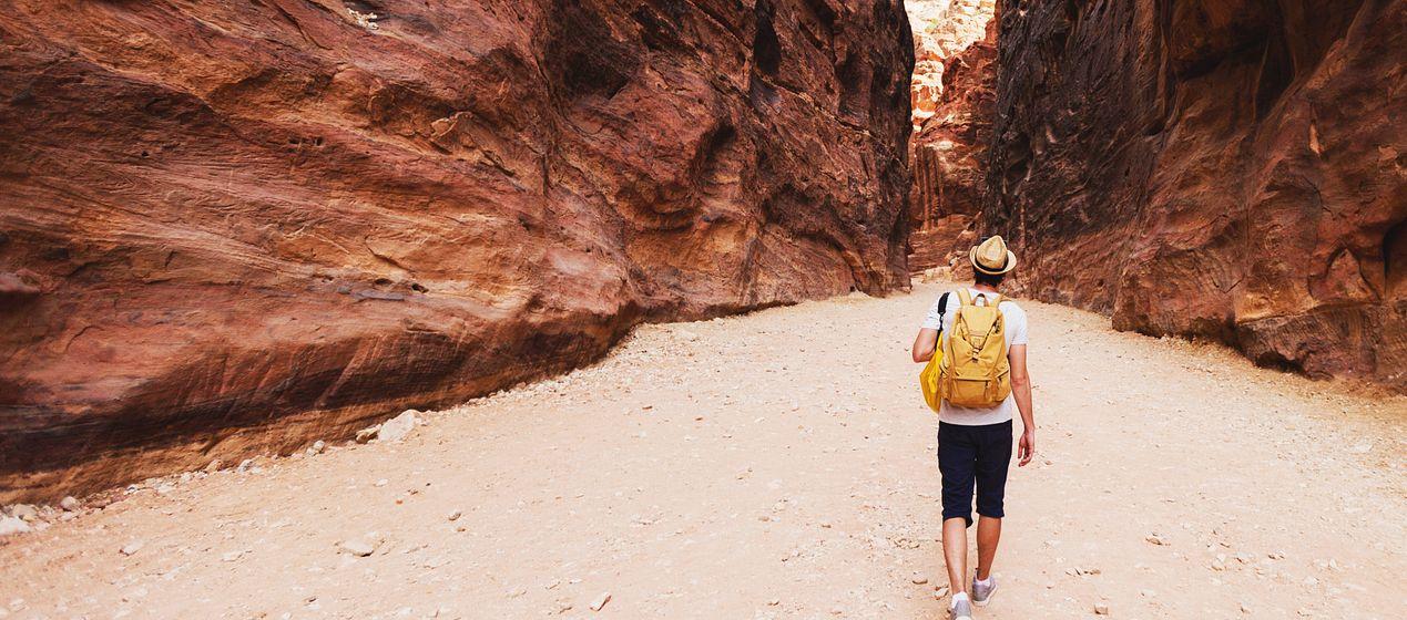 student walking through desert