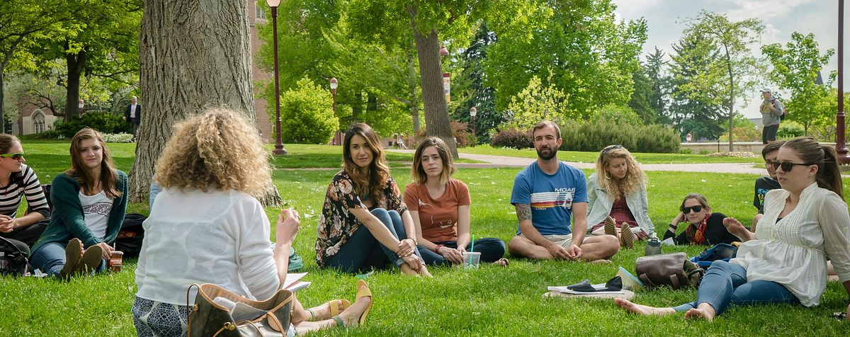 students talking on DU campus