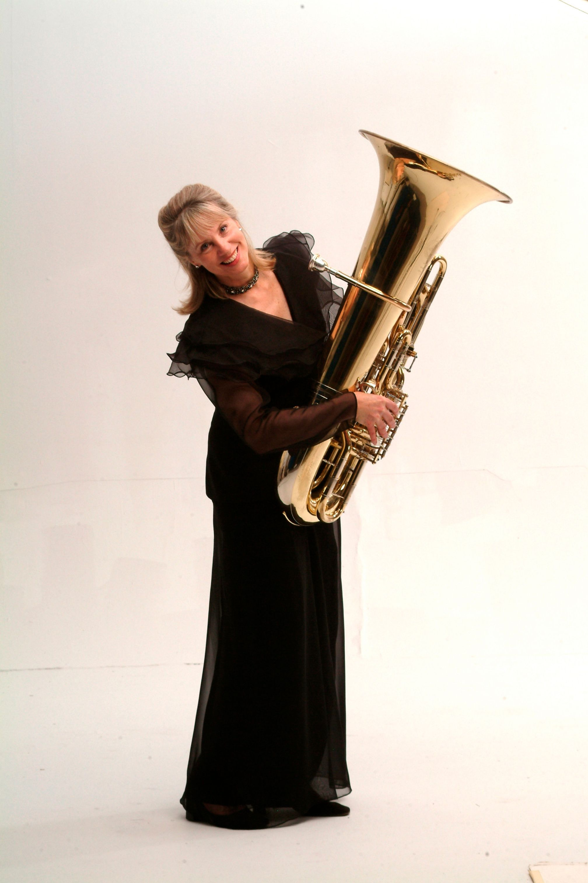 Kathleen Brantigan holding a tuba