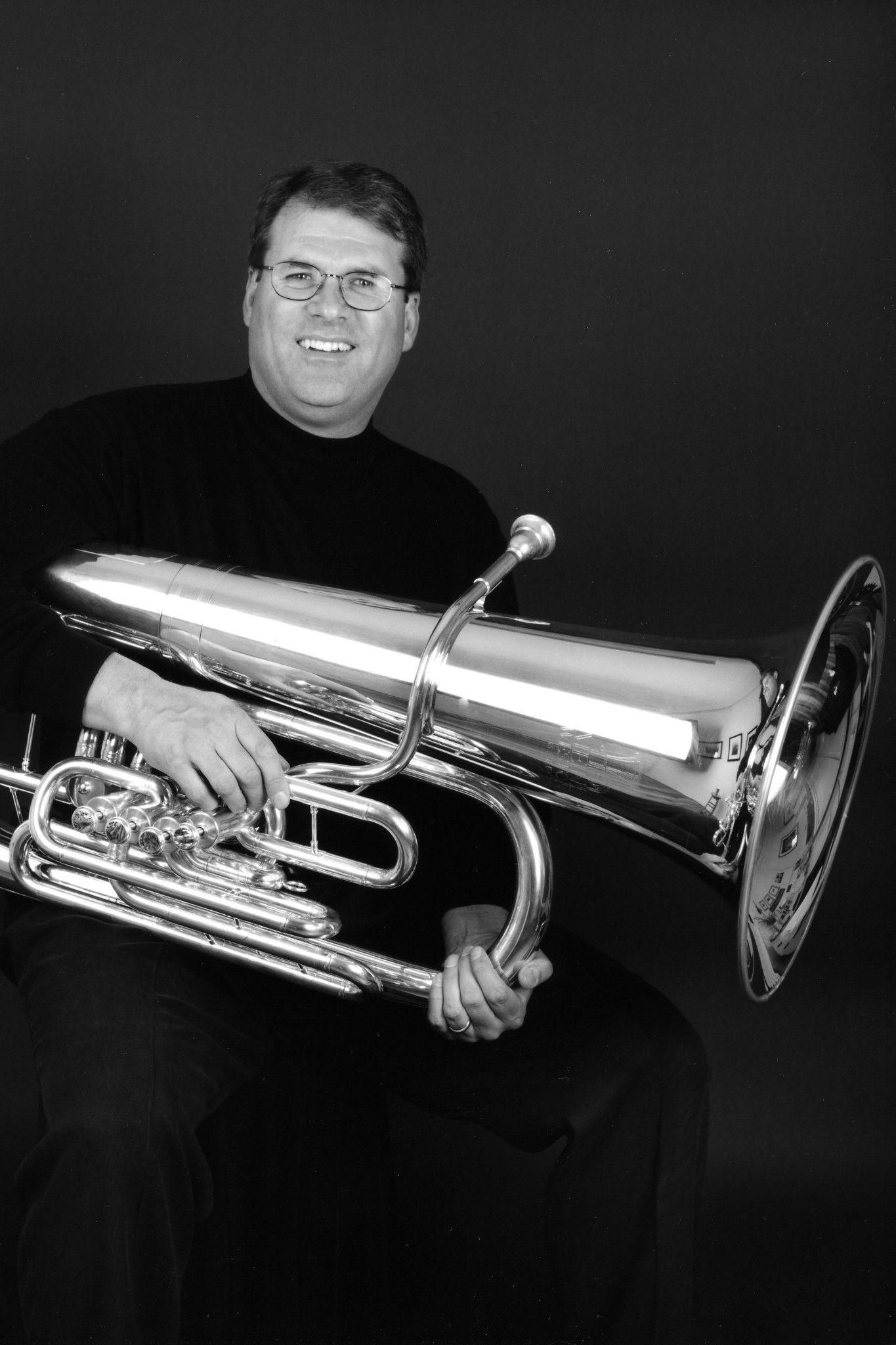 Warren Deck holding a tuba