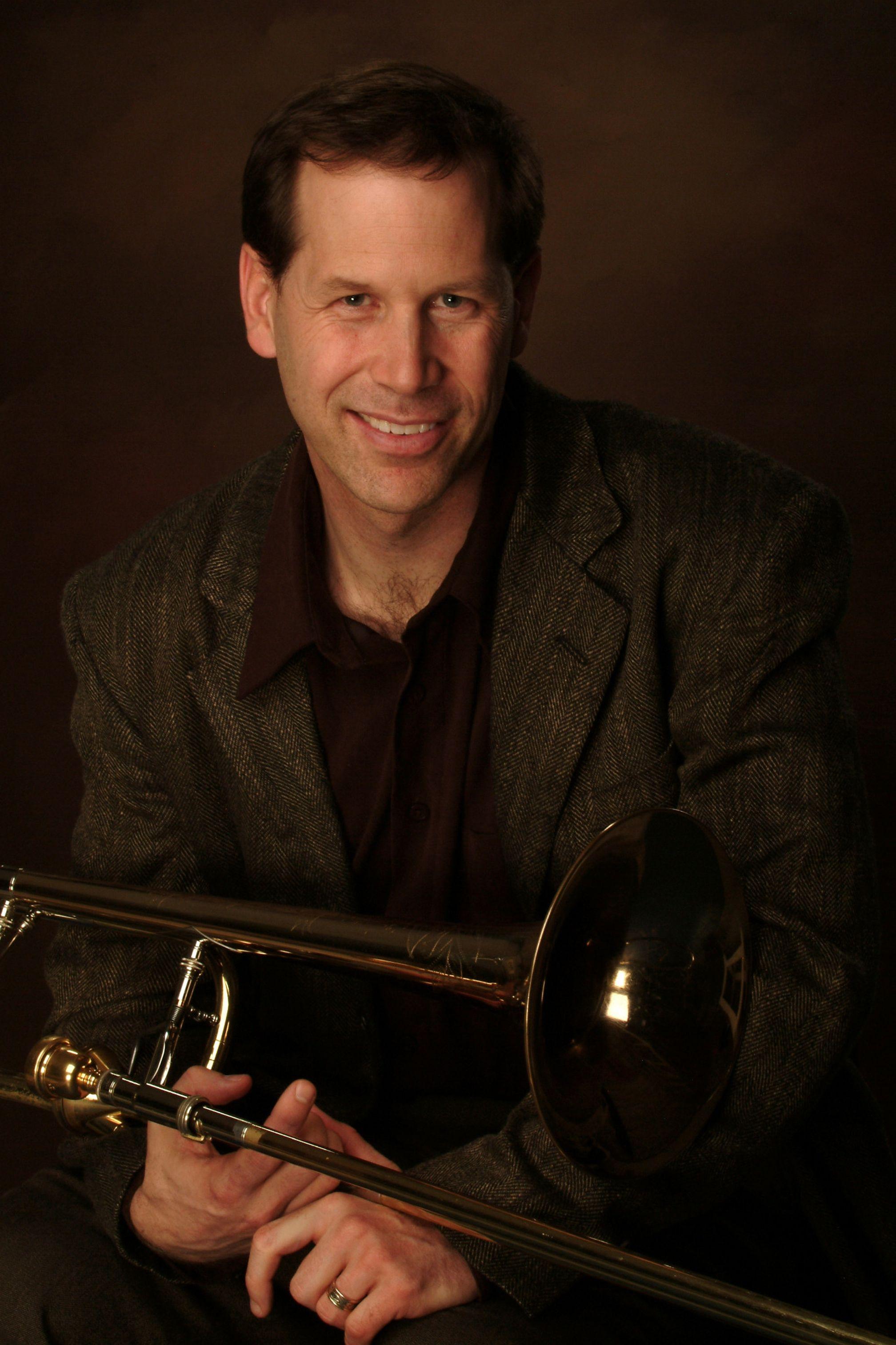Joseph Martin holding a trombone