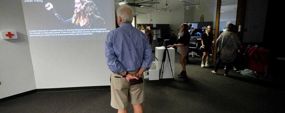 man looking at EDP capstone exhibit