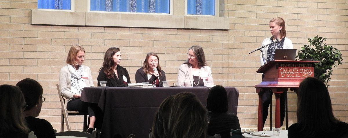 Panelists speaking at an educational gathering.