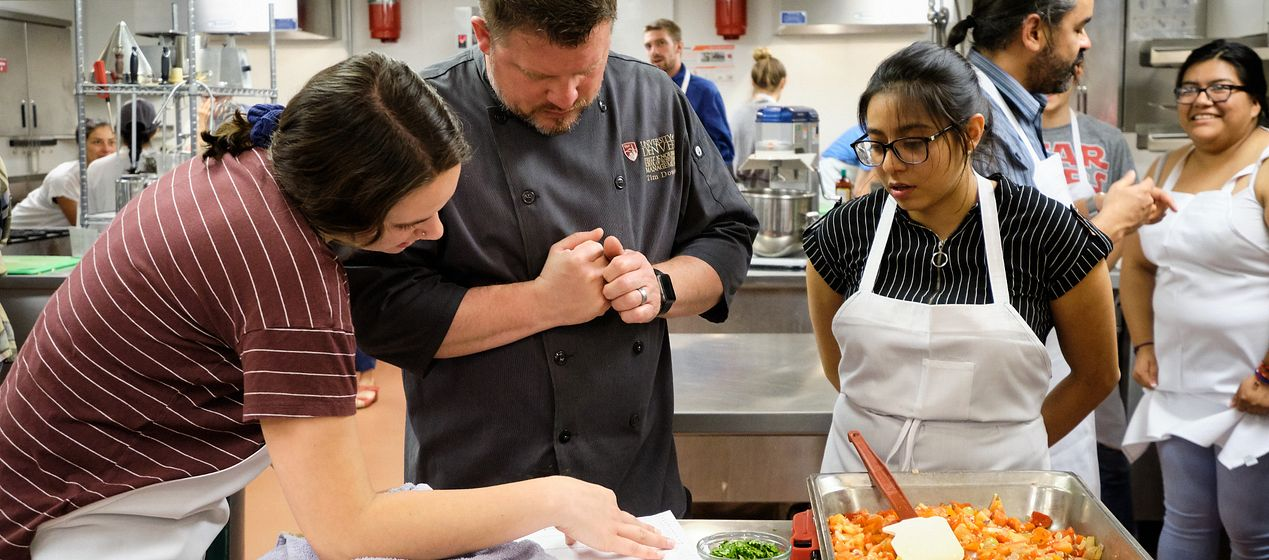 Chef Adrian Miller worked with students on the recipes.