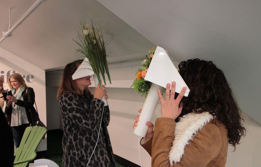 two women looking through viewfinders