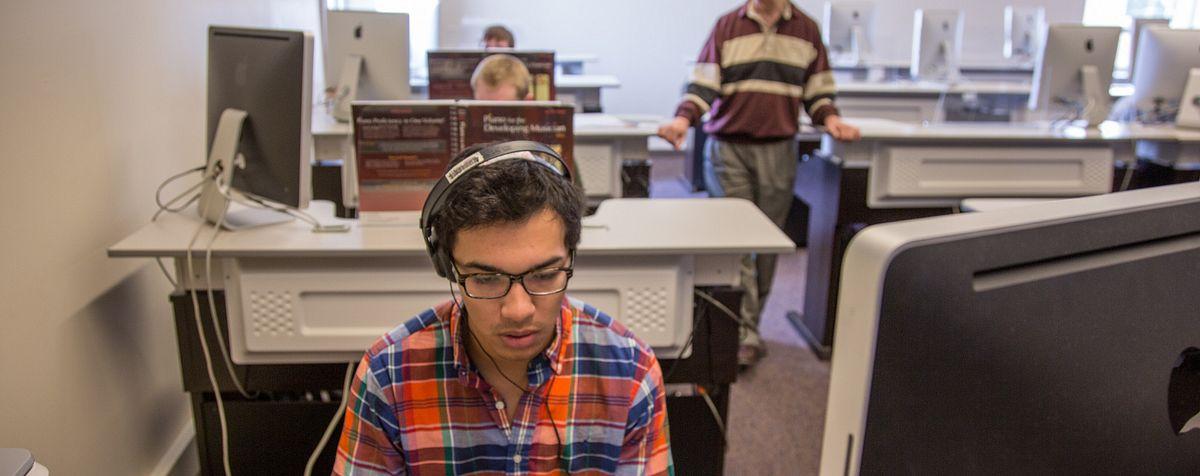 students recording at computers