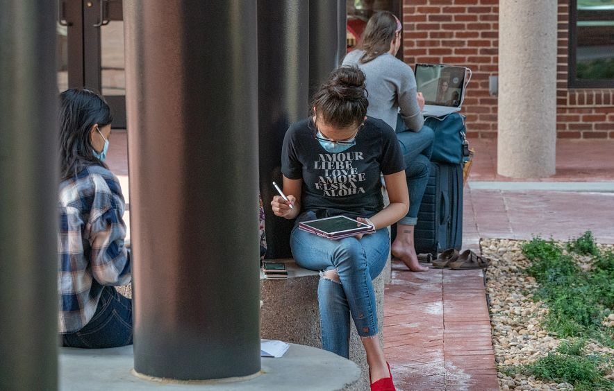 student studying on DU's campus