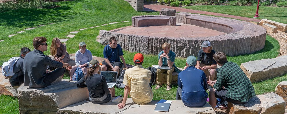 Students learning outside on DU's campus