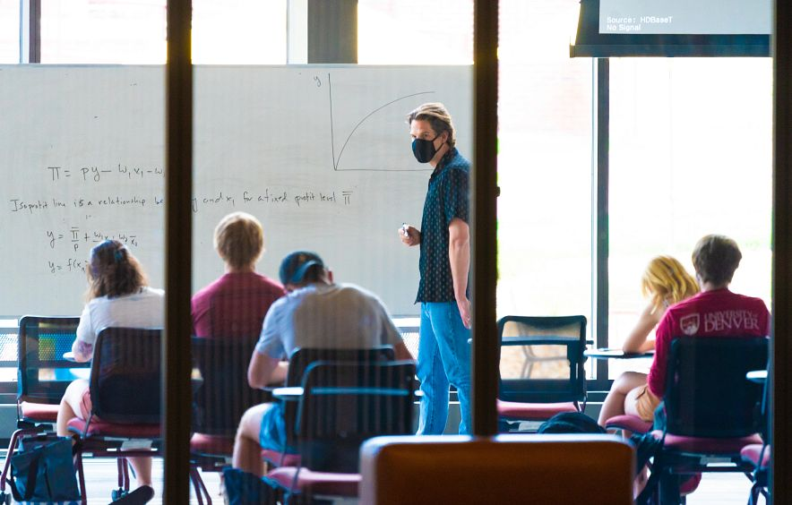 students and faculty wearing masks in a classroom