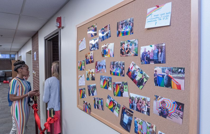 cork board with photos of students celebrating pride