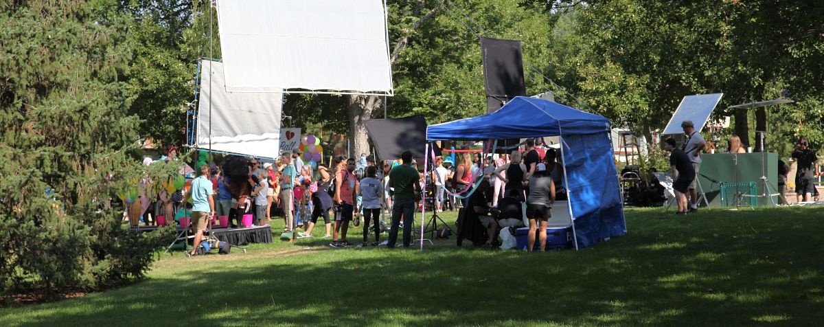 alumni work with students on a film set.