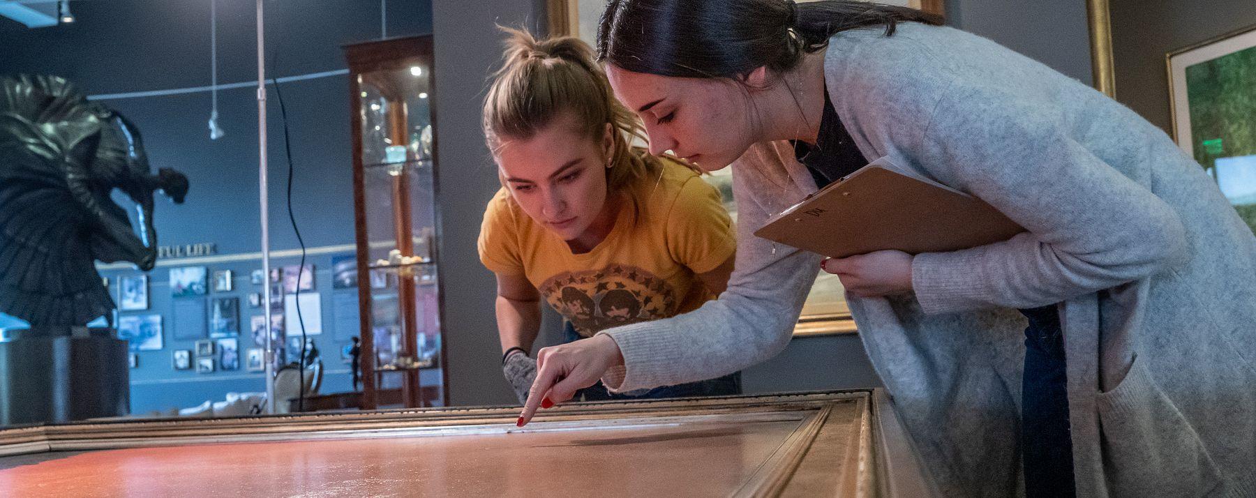 students examining painting