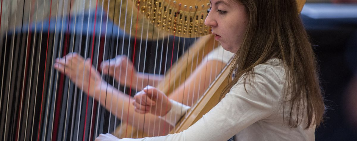 Lamont student playing the harp