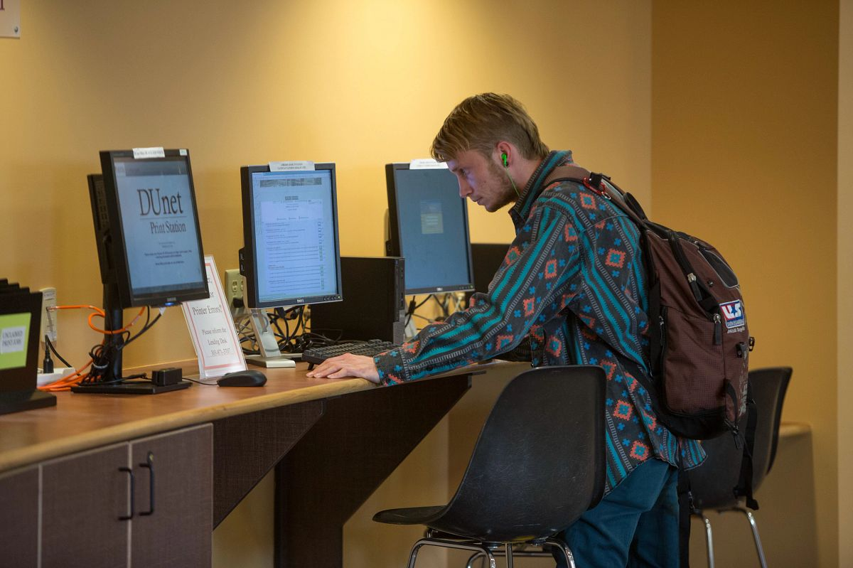 student using library computer