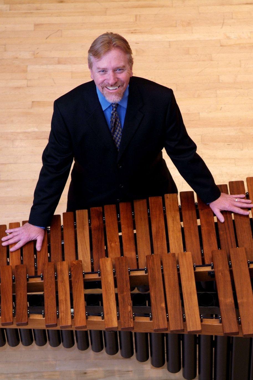 John Kinzie leaning on xylophone