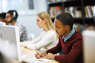 Students doing research at his desk | Elsevier