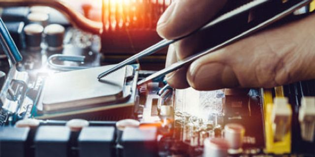 Photo of engineer placing CPU - ScienceDirect | Elsevier Solutions
