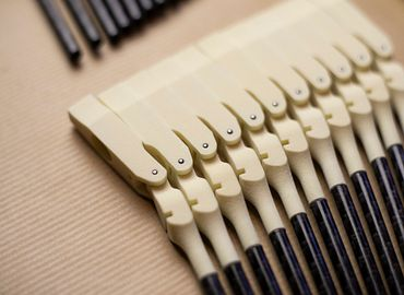 3D printed hammers in a piano. Grand piano with printed components