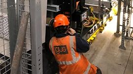 Passenger boarding bridge chain assembly installation service