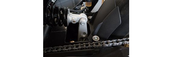 The link helps to absorb shocks on the rear wheel.