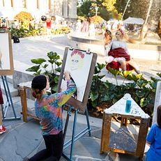 Artists draw a model near Showalter Fountain during the First Thursdays Festival on the Arts Plaza at IU Bloomington on Thursday, Sept. 5, 2019.
