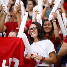 A student watches the proceedings during the Traditions and Spirit of IU at Memorial Stadium on Friday, Aug. 23, 2019.