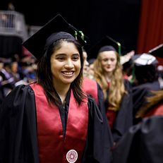 A graduate smiles during the IU Northwest Commencement at the Genesis Convention Center on Thursday, May 9, 2019.