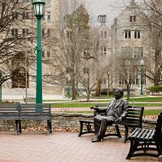 A sculpture of former Indiana University President Herman B Wells sits in the Old Crescent on a spring afternoon at IU Bloomington on Friday, March 20, 2020.