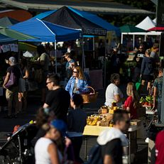 People make their way through the Bloomington Farmer's Market on Saturday, July 25, 2015, in downtown Bloomington.