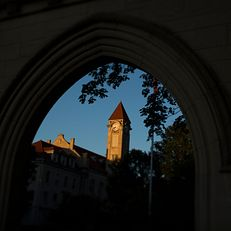 A sunset illuminates the IU Student Building as seen through the Sample Gates on Thursday, July 30, 2015.