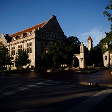 Franklin Hall, left, the Sample Gates and the Frances Morgan Swain Student Building clocktower are pictured on a summer evening at IU Bloomington on Thursday, June 27, 2019.