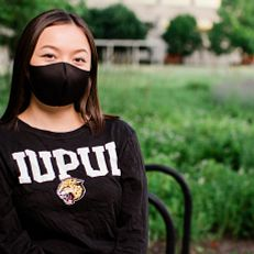 An IUPUI student wearing a mask poses for a photo outside the ICTC building. Physical-distancing guidelines were followed while capturing this photo. Photo taken Thursday, June 25, 2020.