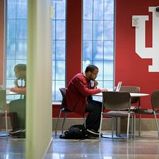 IU senior Christopher Reid studies on a laptop during the first day of spring semester classes on Monday, Jan. 12, 2015, inside of Hodge Hall at the Kelley School of Business.