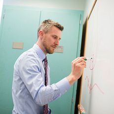 Ben Motz draws a synapse between neurons on a whiteboard on Wednesday, Feb. 25, 2015, in the Psychology Building. Motz, a Senior Lecturer and Director of Pedagogy, won the PresidentÕs Award in Teaching and will be honored at the Distinguished Teaching Awards.