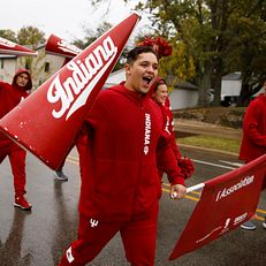 Indiana University cheerleaders walk in the IU Bloomington Homecoming Parade on Friday, Oct. 11, 2019.