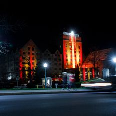 A holiday candle illuminates the Indiana Memorial Union Biddle Hotel and Conference Center tower after a lighting ceremony at IU Bloomington on Tuesday, Nov. 17, 2020.