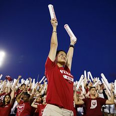 Indiana University Orientation Team member Kindjal Yu pumps up the crowd during the Traditions and Spirit of IU at Memorial Stadium on Friday, Aug. 23, 2019.
