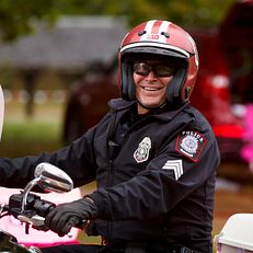 An Indiana University Police Department officer rides a motorcycle in the IU Bloomington Homecoming Parade on Friday, Oct. 11, 2019.