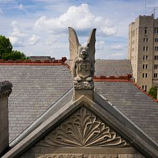 A limestone grotesque sits atop Maxwell Hall as pictured from the air on a summer day at IU Bloomington on Thursday, June 6, 2019.